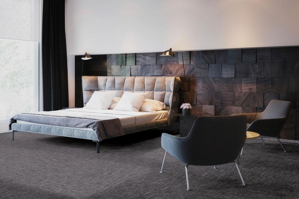 une chambre d'hôtel dans un camaïeu de bois sombres