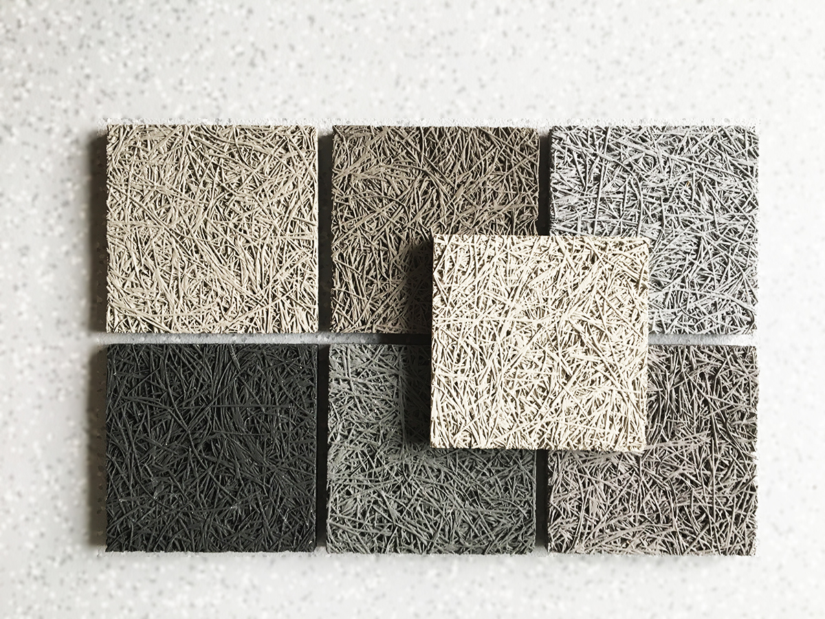 7 échantillons de panneaux de laine de bois, dans un dégradé de teintes naturelles, illustrent la tendance Urban line.