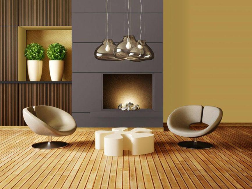 un salon où trône une belle cheminée contempraine. Devant deux fauteuils design. Le smurs sont peints en jaune doré