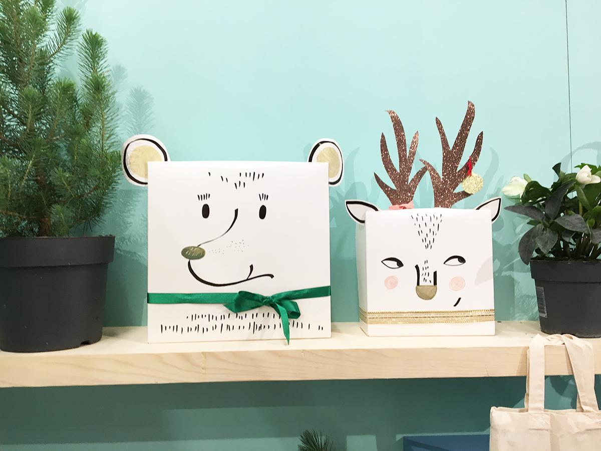 deux boîtes cadeaux en forme de tête d'ours et de renne.