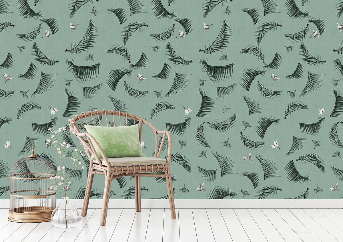 un fauteuil en rotin devant un mur tapissé de revêtement mural Green Forest Grosfillex